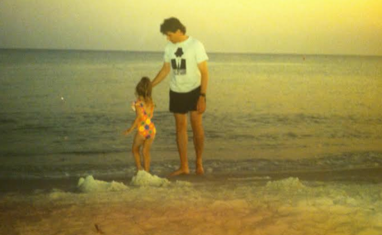 "This has always one of my favorite ""Daddy"" photographs. Our oldest daughter, Savannah, was just a little girl. A perfect moment. At the ocean with my little girl dancing in the waves as she wraps me around her finger."