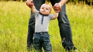 baby-boy-learns-to-walk-with-father